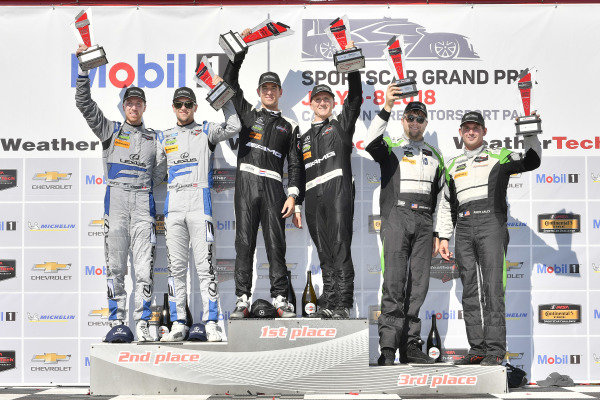 #33 Riley Motorsports Mercedes AMG GT3, GTD: Jeroen Bleekemolen, Ben Keating celebrates the win in Victory Lane on the podium with #14 3GT Racing Lexus RCF GT3, GTD: Dominik Baumann, Kyle Marcelli, #44 Magnus Racing Audi R8 LMS GT3, GTD: John Potter, Andy Lally
