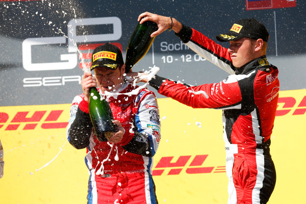 2014 GP3 Series. Round 8.   Sochi Autodrom, Sochi, Russia. Sunday Race 2 Sunday 12 October 2014. Patric Niederhauser (SUI, Arden International) and Marvin Kirchhofer (GER, ART Grand Prix) spray the champagne on the podium. Photo: Alastair Staley/GP3 Series Media Service. ref: Digital Image _79P5824