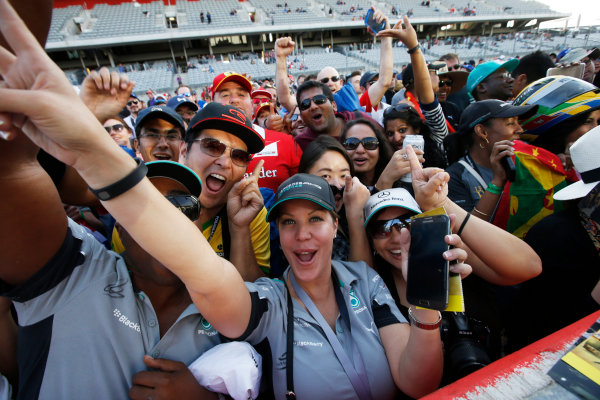Circuit of the Americas, Austin, Texas, United States of America. Sunday 2 November 2014. Fans celebrate after the race. World Copyright: Charles Coates/LAT Photographic. ref: Digital Image _J5R1430
