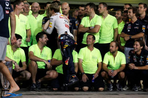 Yas Marina Circuit, Abu Dhabi, United Arab Emirates. Sunday 3rd November 2013. Sebastian Vettel, Red Bull Racing, 1st position, and the Red Bull team celebrate. World Copyright: Charles Coates/LAT Photographic. ref: Digital Image _N7T9369