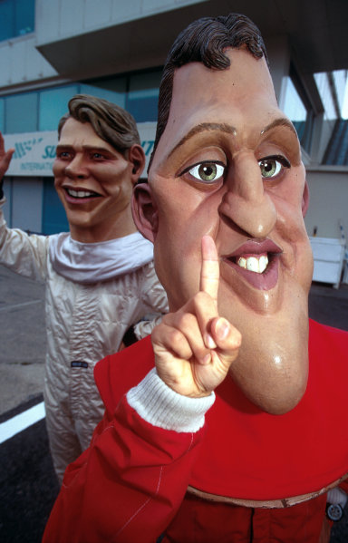 Suzuka, Japan.6-8 October 2000.A Michael Schumacher and Mika Hakkinen caricature add some fun to the Grand Prix.World copyright - LAT Photographic