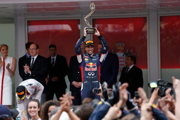 Monte Carlo, Monaco. Sunday 25 May 2014. Daniel Ricciardo, Red Bull Racing, 3rd Position, lifts his trophy on the podium. World Copyright: Andrew Ferraro/LAT Photographic. ref: Digital Image _FER7099