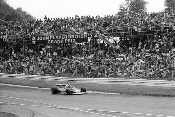Race winner Carlos Reutemann (ARG) Ferrari 312T3 passes the packed grandstand at the end of the lap.