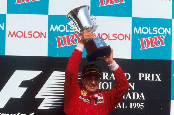 Montreal, Quebec, Canada.9-11 June 1995.Jean Alesi (Ferrari) 1st position, celebrates his maiden Grand Prix win on the podium.Ref-95 CAN 04.World Copyright - LAT Photographic