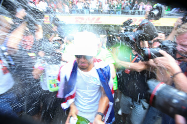 Autodromo Hermanos Rodriguez, Mexico City, Mexico. Sunday 29 October 2017. Lewis Hamilton, Mercedes AMG, sprays Champagne at photographers in celebration of securing his 4th world drivers championship title. World Copyright: Charles Coates/LAT Images  ref: Digital Image DJ5R7725