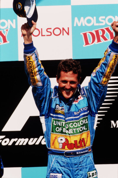 1994 Canadian Grand Prix.Montreal, Quebec, Canada.10-12 June 1994.Michael Schumacher (Benetton Ford) celebrates 1st position on the podium.Ref-94 CAN 03.World Copyright - LAT Photographic