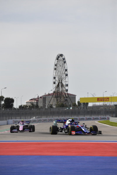 Pierre Gasly, Toro Rosso STR14, and Lance Stroll, Racing Point RP19