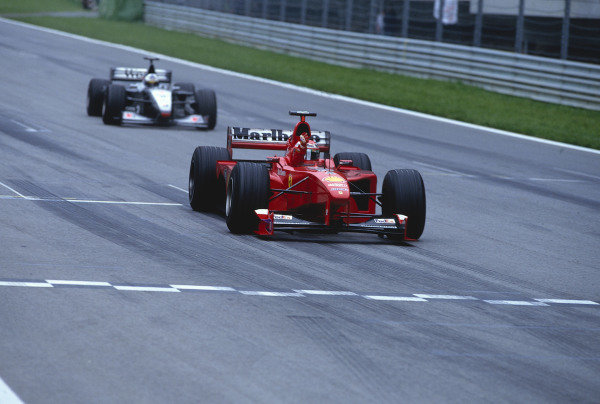1999 Austrian Grand Prix.A1 Ring, Zeltweg, Austria.23-25 July 1999.Eddie Irvine (Ferrari F399) celebrates as he crosses the finish line for 1st position.Ref-99 AUT 03.World Copyright - LAT Photographic