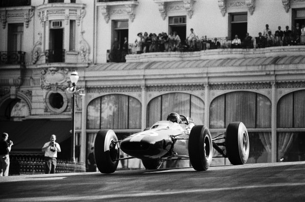 Jim Clark, Lotus 25 Climax, crests the rise at Casino Square.