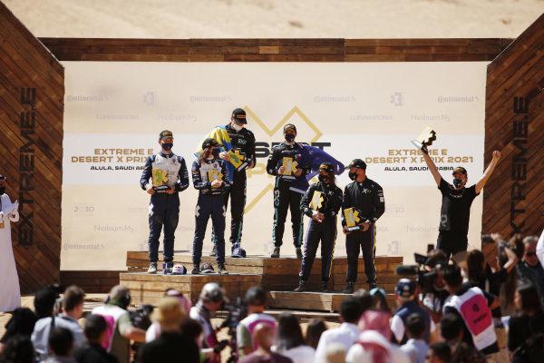 Timmy Hansen (SWE), Andretti United Extreme E, Catie Munnings (GBR), Andretti United Extreme E, Johan Kristoffersson (SWE), Rosberg X Racing, Molly Taylor (AUS), Rosberg X Racing, Cristina Gutierrez (ESP), X44, and Sebastien Loeb (FRA), X44, celebrate on the podium