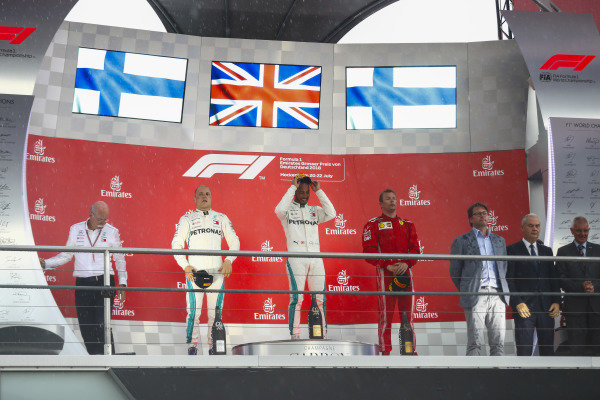 Lewis Hamilton, Mercedes AMG F1, Valtteri Bottas, Mercedes AMG F1, and Kimi Raikkonen, Ferrari, on the podium.
