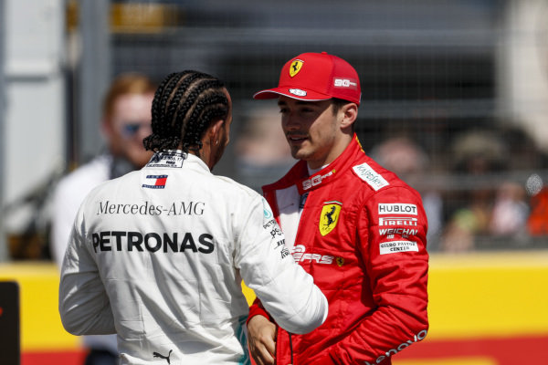 Pole Sitter Lewis Hamilton, Mercedes AMG F1 and Charles Leclerc, Ferrari speak with Paul di Resta, Sky, TV in Parc Ferme