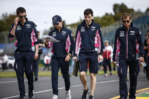 Sergio Perez, Racing Point, walks the track with his team