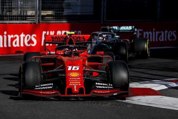 Charles Leclerc, Ferrari SF90 leads Lewis Hamilton, Mercedes AMG F1 W10