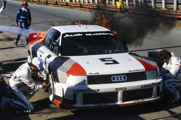 Fire breaks out on the car of Hurley Haywood, Audi 90 quattro, during a pitstop.