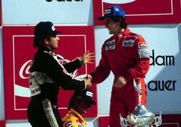 1984 Brazilian Grand Prix, Jacarepagua, Rio de Janeiro, Brazil.23-25 March 1984.Alain Prost (McLaren MP4/2 TAG Porsche) and Elio de Angelis (Lotus 95T Renault), 1st and 3rd positions respectively.  Ref: 84BRA06. World Copyright - LAT Photographic