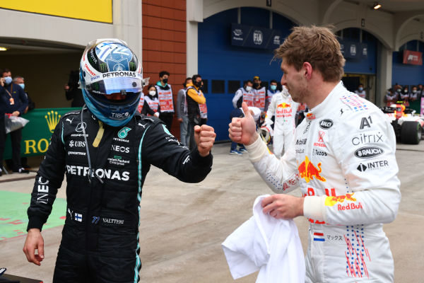 Valtteri Bottas, Mercedes, 1st position, is congratulated by Max Verstappen, Red Bull Racing, 2nd position, in Parc Ferme