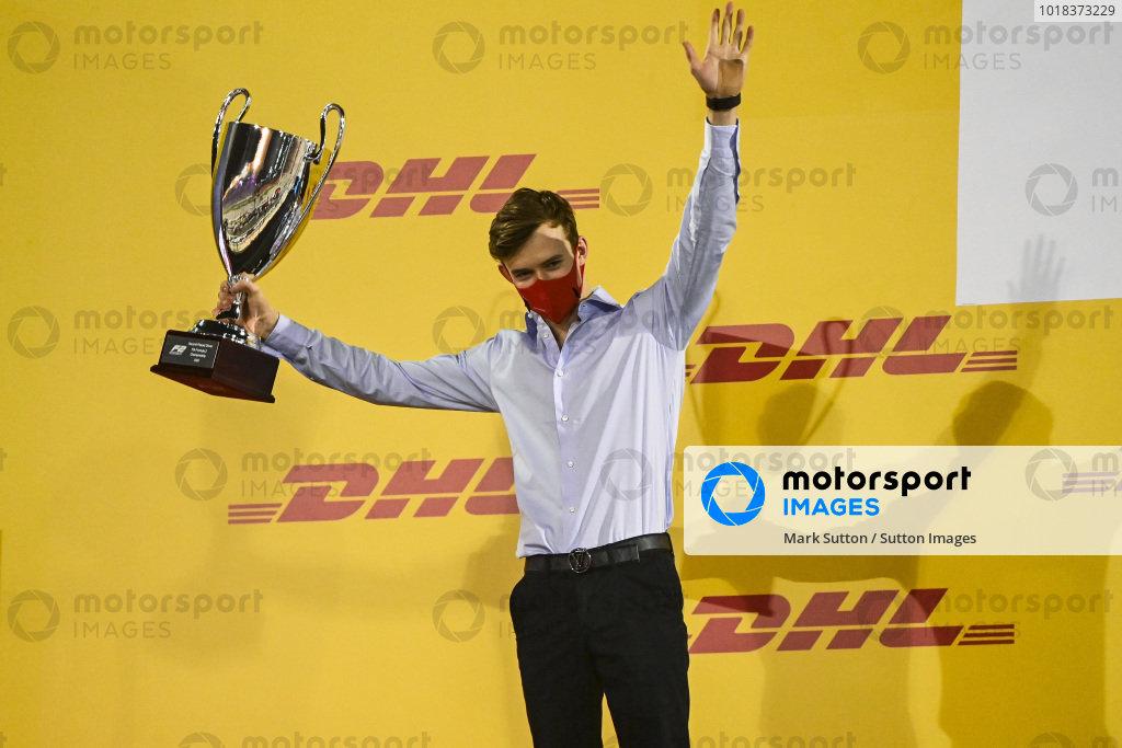 F2 Championship 2nd position Callum Ilott (GBR, UNI-VIRTUOSI) celebrates on the podium with the trophy