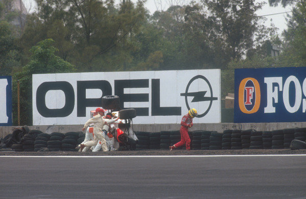 1991 Mexican Grand Prix.Mexico City, Mexico. 14-16 June 1991.Ayrton Senna (McLaren MP4/6 Honda) came off at Peraltada during Friday qualifying and hit the tyre barrier, which flipped his car over in the gravel. He was unhurt in the accident. Ref-91 MEX 09.World Copyright - Tee/LAT Photographic