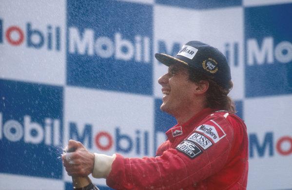 1990 Belgian Grand Prix.Spa-Francorchamps, Belgium.24-26 August 1990.Ayrton Senna (McLaren Honda) celebrates his 1st position on the podium.Ref-90 BEL 02.World Copyright - LAT Photographic