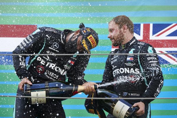 Lewis Hamilton, Mercedes-AMG Petronas F1, 1st position, and Valtteri Bottas, Mercedes-AMG Petronas F1, 3rd position, celebrate Champagne on the podium
