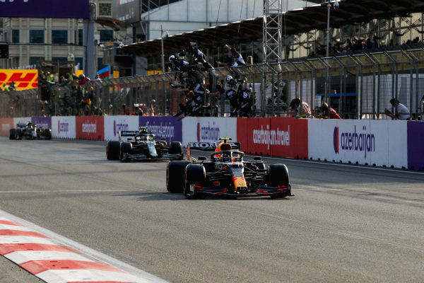 Sergio Perez, Red Bull Racing RB16B, 1st position, takes victory