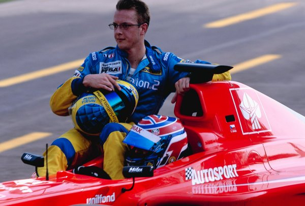 2002 International F3000Monza, Italy. 14th September 2002 3rd position secured the championship title for Tomas Enge (Arden), and he gives a lift back to the pits to his closest rival Sebastien Bourdais (Super Nova).World Copyright: Clive Rose/LAT Photographic ref: 35mm Image A21