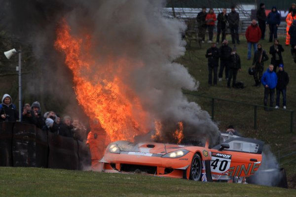 2013 Avon Tyres British GT Championship, Oulton Park, Cheshire. 30th March - 1st April 2013. The car of Colin White IDL - CWS Ginetta G55 GT3 catches fire in Race 2. World Copyright: Ebrey / LAT Photographic.