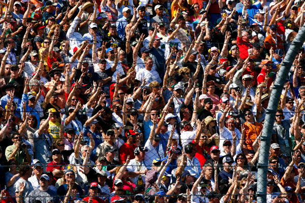 20 February, 2011, Daytona Beach, Florida, USAFans salute Dale Earnhardt with three fingers on lap 3©2011, LAT SouthLAT Photo USA