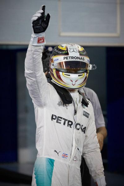 Bahrain International Circuit, Sakhir, Bahrain. Saturday 2 April 2016. Lewis Hamilton, Mercedes AMG, celebrates pole in Parc Ferme. World Copyright: Steve Etherington/LAT Photographic ref: Digital Image SNE25224