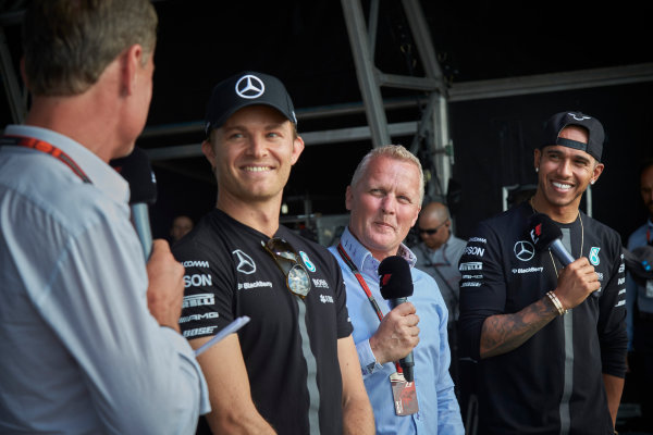 Silverstone Circuit, Northamptonshire, England. Saturday 4 July 2015. Lewis Hamilton, Mercedes AMG, and Nico Rosberg, Mercedes AMG, on stage with Johnny Herbert, Pundit, Sky Sports F1, and David Coulthard, Commentator, BBC Sport F1. World Copyright: Steve Etherington/LAT Photographic ref: Digital Image SNE18753
