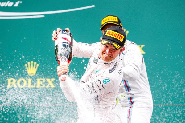 Red Bull Ring, Spielberg, Austria. Sunday 21 June 2015. Nico Rosberg, Mercedes AMG, 1st Position, sprays the Champagne from the podium. World Copyright: Glenn Dunbar/LAT Photographic. ref: Digital Image _89P5760