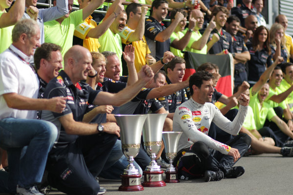 Autodromo Nazionale di Monza, Monza, Italy. 8th September 2013. Adrian Newey, Chief Technical Officer, Red Bull Racing, Sebastian Vettel, Red Bull Racing, 1st position, Mark Webber, Red Bull Racing, 3rd position, and the Red Bull team celebrate. World Copyright: Andy Hone/LAT Photographic. ref: Digital Image HONY8638