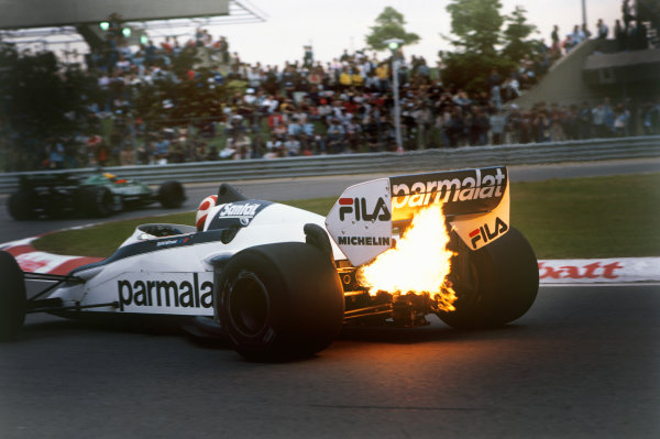 Montreal, Canada. 10-12 June 1983. Exhaust flame from Nelson Piquet's Brabham BT52 BMW as he follows Michele Alboreto, Tyrrell 011 Ford. Ref: 83CAN07. World Copyright - LAT Photographic