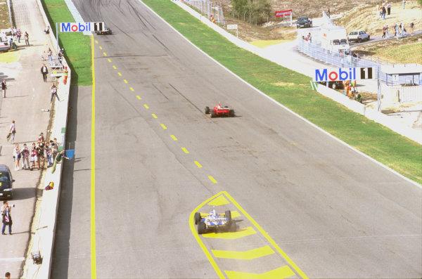 Jerez, Spain.24-26 October 1997.Jacques Villeneuve (Williams FW19 Renault) exits the pits behind Michael Schumacher (Ferrari F310B) after his pitstop.Ref-97 EUR 13.World Copyright - LAT Photographic