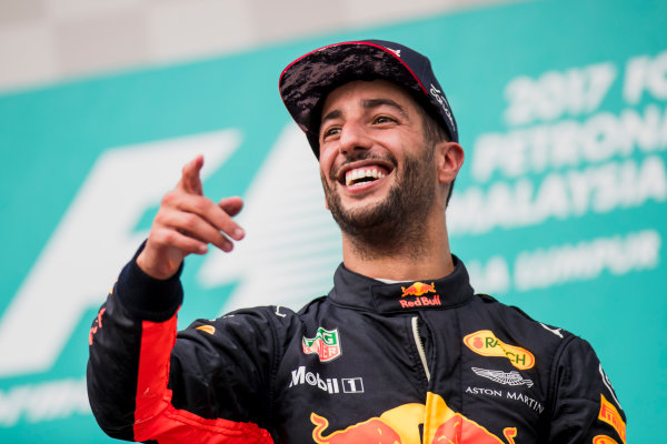 Sepang International Circuit, Sepang, Malaysia. Sunday 1 October 2017. Daniel Ricciardo, Red Bull Racing, 3rd Position, celebrates on the podium. World Copyright: Zak Mauger/LAT Images  ref: Digital Image _56I3594