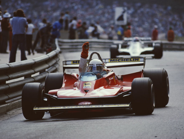 Jody Scheckter, Ferrari 312T4, celebrates winning the race.