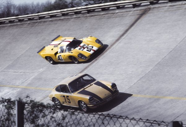 1969 Monza 1000kms.Monza, Italy. 25th April 1969.Jo Bonnier/Herbert Muller, Lola T70 Mk3B, retired, passes the Vincenzo Carrago/Michele Licheri, Porsche 911T, in qualifying,  action.World Copyright: LAT PhotographicRef: