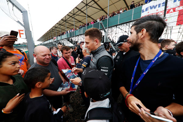 Silverstone, Northamptonshire, UK.  Thursday 13 July 2017. Stoffel Vandoorne, McLaren, signs autographs for fans. World Copyright: Glenn Dunbar/LAT Images  ref: Digital Image _X4I2892