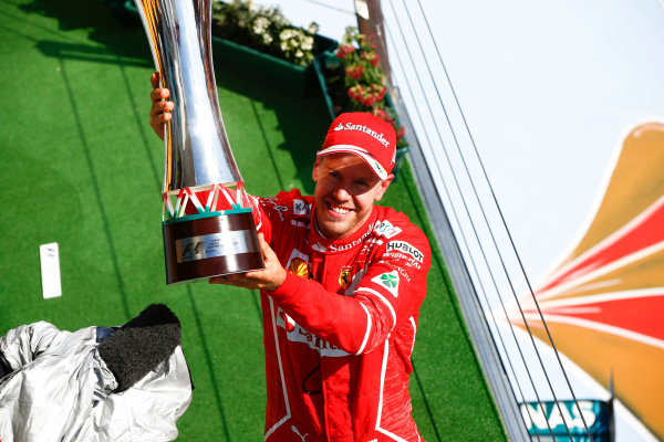 Hungaroring, Budapest, Hungary.  Sunday 30 July 2017. Sebastian Vettel, Ferrari, 1st Position, celebrates on the podium with his trophy. World Copyright: Andrew Hone/LAT Images  ref: Digital Image _ONZ1168