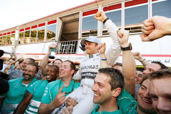 Monte Carlo, Monaco 26th May 2013 Nico Rosberg celebrates his win with the Mercedes team.  World Copyright: Charles Coates/LAT Photographic ref: Digital Image _N7T1326