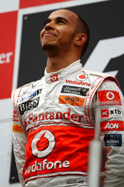 Nurburgring, Germany.24th July 2011Lewis Hamilton, McLaren MP4-26 Mercedes, 1st position, on the podium. Portrait. Podium. World Copyright: Andy Hone/LAT Photographicref: Digital Image CSP13428