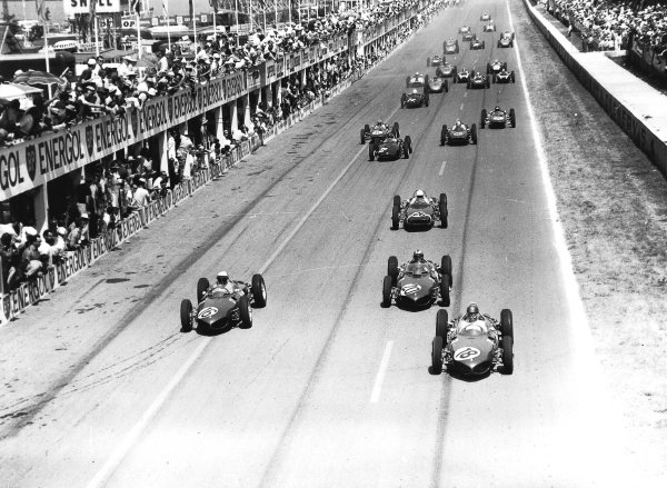 Reims, France.30/6-2/7 1961.Richie Ginther leads Phil Hill, Wolfgang von Trips (all Ferrari Dino 156), Stirling Moss (Lotus 18-Climax), Graham Hill (BRM P48/57-Climax), John Surtees (Cooper T53-Climax), Innes Ireland, Jim Clark, (both Lotus 21-Climax) and Tony Brooks (BRM P48/57-Climax) at the start.Ref-Autocar C62362.World Copyright - LAT Photographic