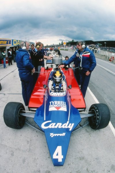 Ken Tyrrell (GBR) Tyrrell Team Owner (right) beside the car of Derek Daly (IRE) Tyrrell 010 in the pits.