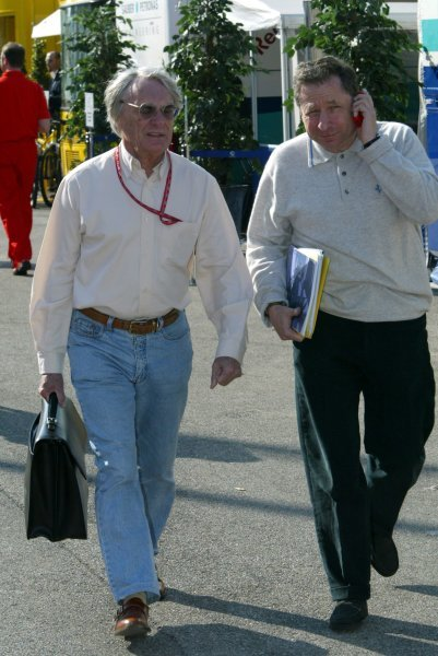(L to R): Bernie Ecclestone (GBR) F1 Supremo and Jean Todt (FRA) Ferrari General Manager in the paddock.Formula One World Championship, Rd4, San Marino Grand Prix, Preparations, Imola, Italy, 17 April 2003.DIGITAL IMAGE