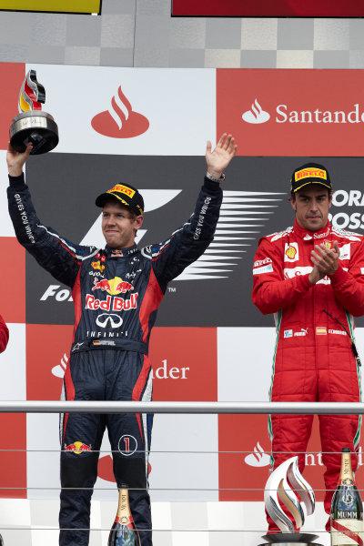 Hockenheimring, Hockenheim, Germany 22nd July 2012 Fernando Alonso, Ferrari, 1st position, and Sebastian Vettel, Red Bull Racing, 2nd position, on the podium. World Copyright: Steve Etherington/LAT Photographic ref: Digital Image HC5C5914 copy