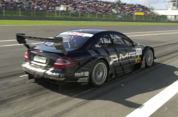2002 DTM Championship Nurburgring, Germany. 2th - 4th August 2002. Race winner Uwe Alzen (Mercedes CLK-DTM) crosses the finish line.World Copyright: Andre Irlmeier/LAT Photographic