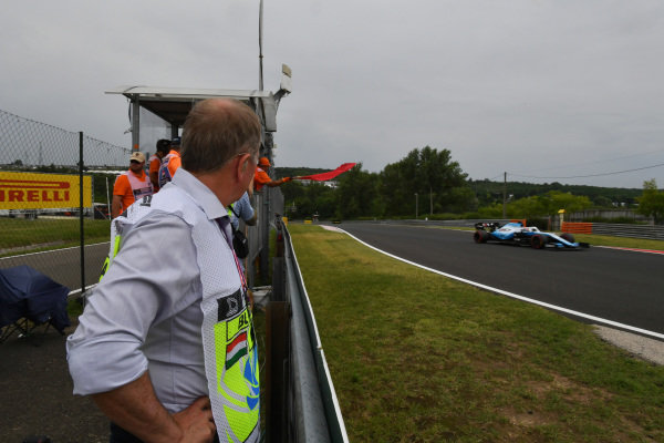 Martin Brundle, Sky Sports F1, watches as George Russell, Williams Racing FW42, passes