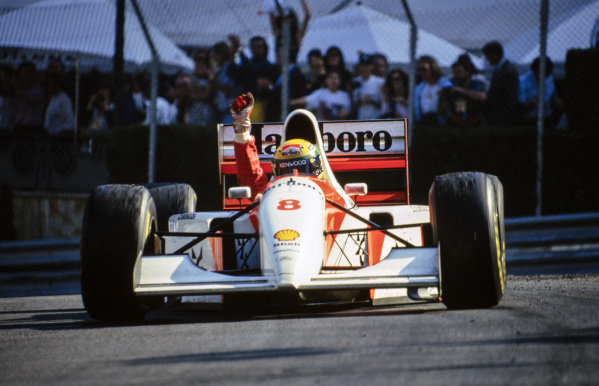 Ayrton Senna, McLaren MP4-8 Ford, celebrates his record-breaking sixth victory on the streets of Monte Carlo.