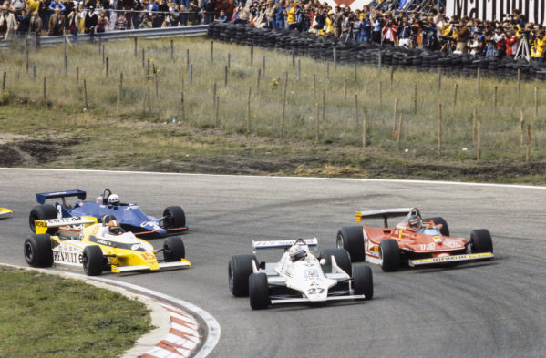 Alan Jones, Williams FW07 Ford leads Gilles Villeneuve, Ferrari 312T4, Jean-Pierre Jabouille, Renault RS10 and Didier Pironi, Tyrrell 009 Ford.